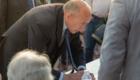Gérard Collomb ministre d'interieur signe photographe Armen Hambardzumian